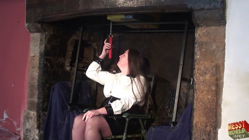Michaela Wearing PVC in The Grand Fireplace