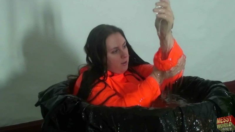 Michaela Wears Rainwear In The Tub